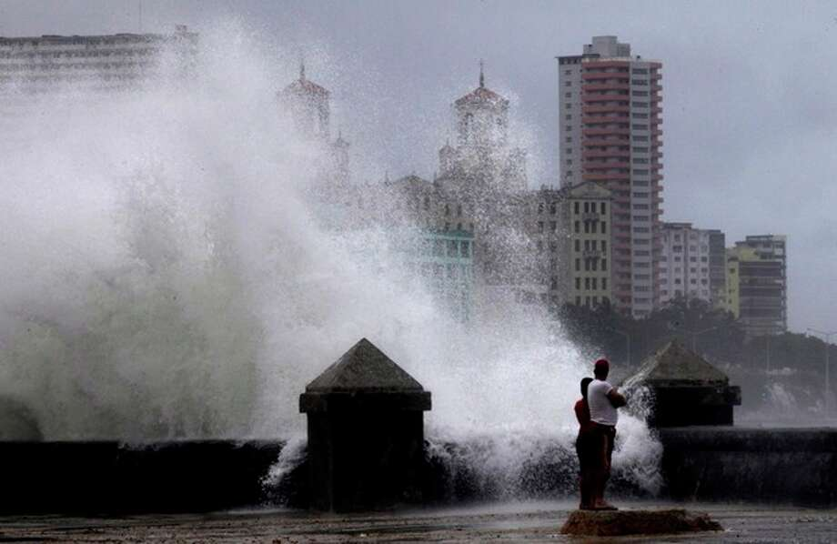 Waves pound the boardwalk, the Malecon, during the passing of Tropical Storm Isaac in Havana Cuba, Sunday, Aug. 26, 2012. The hurricane center said the storm, which was swirling north of the central coast of Cuba in the pre-dawn hours, was expected to be near or over the Florida Keys sometime later Sunday or Sunday night. (AP Photo/Ramon Espinosa) / AP
