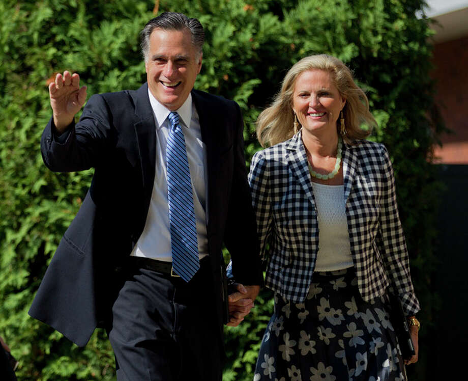 The Republican presidential candidate, former Massachusetts Gov. Mitt Romney, and his wife Ann walk into the Church of Jesus Christ of Latter-day Saints on Sunday, Aug. 26, 2012, in Wolfeboro, N.H. (AP Photo/Evan Vucci) / AP