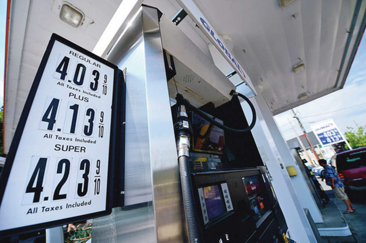 Gas prices have topped four dollars like at the Global station on Main Ave in Norwalk. Hour photo / Erik Trautmann
