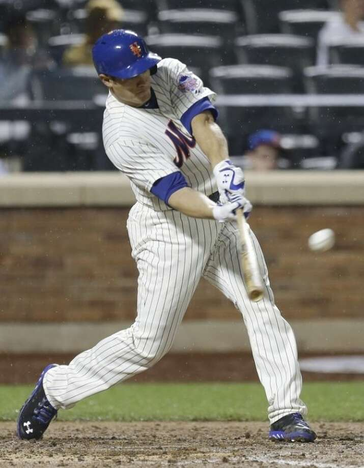 New York Mets' Anthony Recker hits a home run during the fifth inning of a baseball game against the Arizona Diamondbacks Tuesday, July 2, 2013, in New York. (AP Photo/Frank Franklin II)
