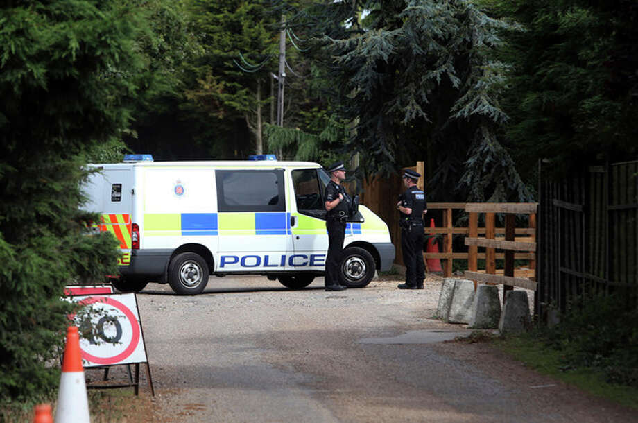 Police stand at Earls Hall Farm in St Osyth, southern England where a lion was apparently seen Monday Aug. 27, 2012. Outside the idyllic English village of St. Osyth, police are hunting a lion. A small army of officers and tranquilizer-toting zoo experts, along with a pair of heat-seeking helicopters, are spending their Monday combing the woods, ponds, and farmland around the coastal community after a resident spotted what was believed to be a lion lounging in a field of grass. Where such a beast may have come from is anyone's guess; the local zoo says its animals are accounted for, and police have said a local circus isn't missing any either. (AP Photo/Steve Parsons/PA Wire) UNITED KINGDOM OUT NO SALES NO ARCHIVE / PA