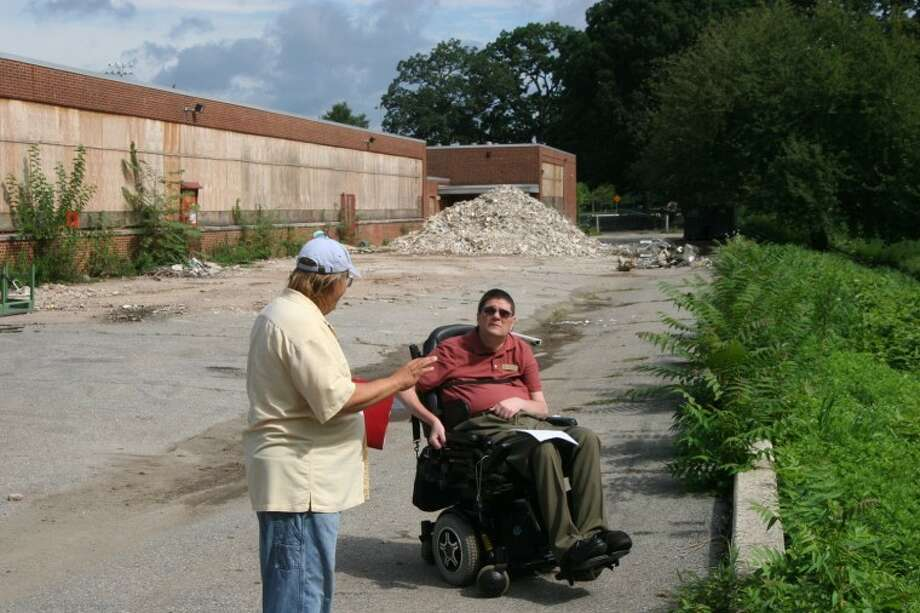 State Rep. Michael Molgano, R-144, right, visits J.M Wright Technical High School after area residents expressed concerns about the state of the school, which is undergoing renovations and scheduled to reopen in 2014. Contributed photo.