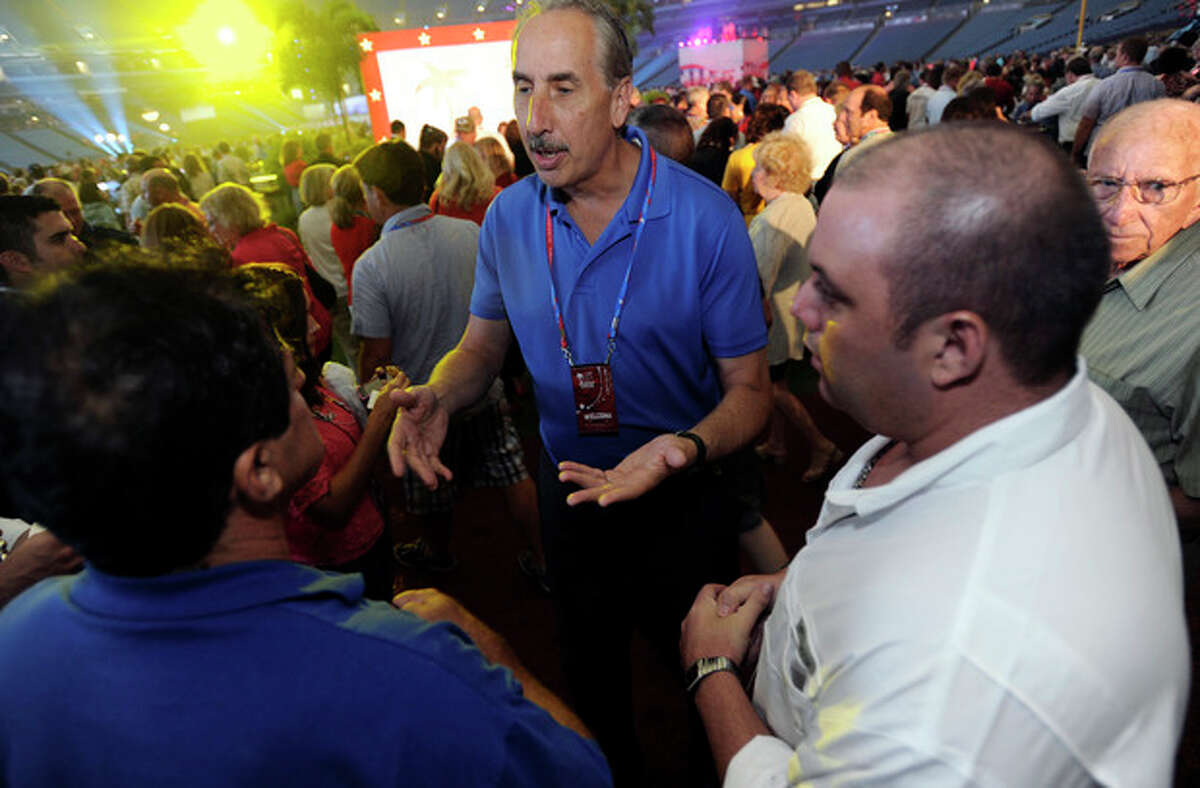 Missouri delegate Eric Zahnd, right, and his wife Tracy attend the 2012 Tampa Bay Host Committee?'s welcoming event for the delegates of the Republican National Convention on Sunday, Aug. 26, 2012 at Tropicana Field in St. Petersburg, Fla. (AP Photo/The Tampa Tribune, Chris Urso, Pool)