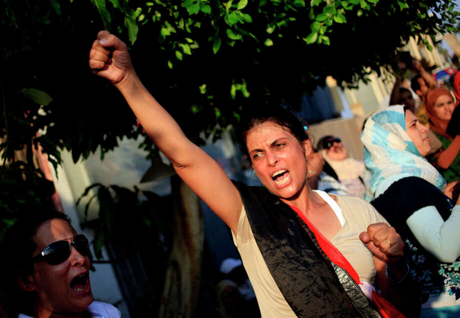 "An opponent of Egypt's Islamist President Mohammed Morsi chants slogans during a protest outside the presidential palace, in Cairo, Egypt, Tuesday, July 2, 2013. Egypt was on edge Tuesday following a ""last-chance"" ultimatum the military issued to Mohammed Morsi, giving the president and the opposition 48 hours to resolve the crisis in the country or have the army step in with its own plan. (AP Photo/Khalil Hamra) / AP"
