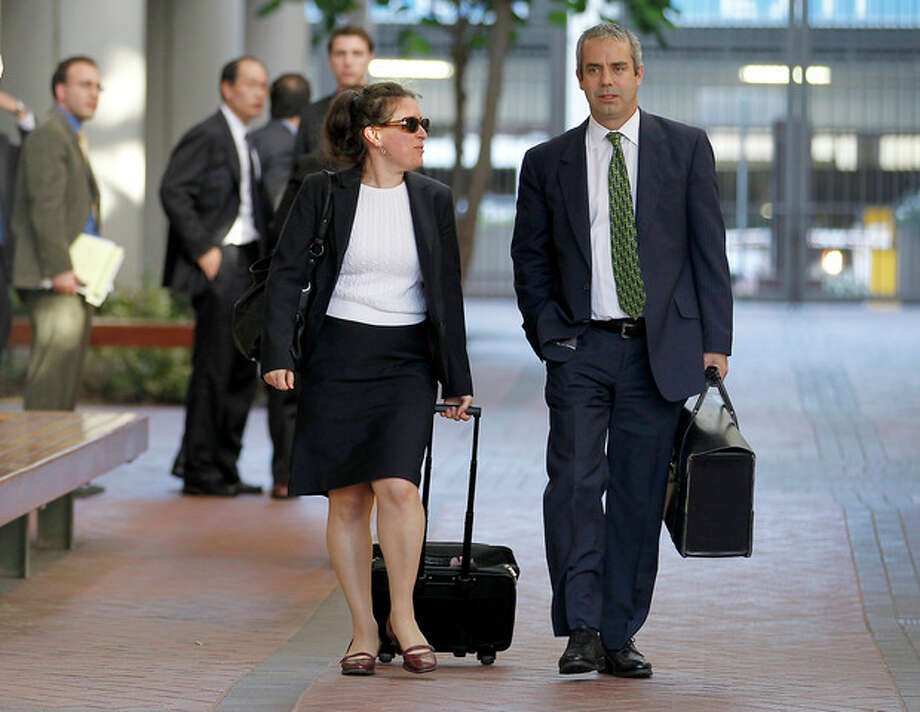 Kevin Johnson, right, and Victoria Maroulis, left, attorneys for Samsung, leave the US Courthouse and Federal building after a jury reached a decision in the Apple Samsung trial on Friday, Aug 24, 2012 in San Jose, Calif. After a year of scorched-earth litigation, a jury decided Friday that Samsung ripped off the innovative technology used by Apple to create its revolutionary iPhone and iPad. The jury ordered Samsung to pay Apple $1.05 billion. An appeal is expected. (AP Photo/Tony Avelar) / FR155217 AP