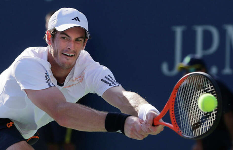 Britain's Andy Murray returns a shot to Alex Bogomolov Jr., of Russia, at the 2012 U.S. Open tennis tournament, Monday, Aug. 27, 2012, in New York. Murray won the match. (AP Photo/Mike Groll) / AP