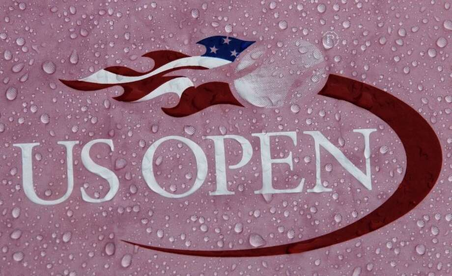 Rain drops cover a logo during a rain delay for the 2012 US Open Tennis tournament, Monday, Aug. 27, 2012, in New York. (AP Photo/Kathy Willens) / AP