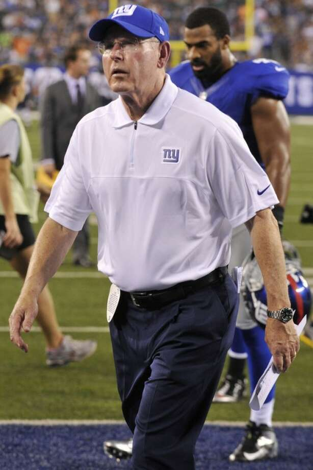 New York Giants coach Tom Coughlin leaves the field after the first half of an NFL preseason football game against the Chicago Bears Friday, Aug. 24, 2012, in East Rutherford, N.J. (AP Photo/Bill Kostroun)
