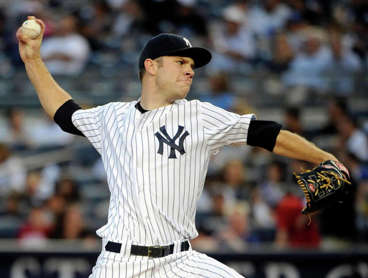 New York Yankees' David Phelps throws against the Toronto Blue Jays in the first inning of a baseball game, Monday, Aug. 27, 2012, at Yankee Stadium in New York. (AP Photo/Kathy Kmonicek)