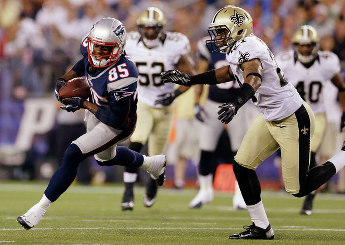 FILE - In this Aug. 9, 2012, file photo, New England Patriots wide receiver Brandon Lloyd (85) pulls away from New Orleans Saints strong safety Corey White (24) during their NFL preseason football game against the New Orleans Saints in Foxborough, Mass. The Patriots followed up a season that saw them lose just three regular-season games and nearly win the Super Bowl by adding a deep receiving threat and solidifying their defense to stack up against a soft schedule. The Patriots are scheduled to begin their regular season on Sept. 9 at the Tennessee Titans. (AP Photo/Elise Amendola, File)