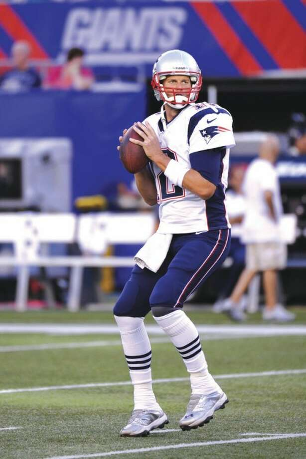 AP photoNew England Patriots quarterback Tom Brady warms up before a preseason game. Despite some obvious deficiencies on both sides of the ball, Brady led the Pats all the way to the Super Bowl last season.