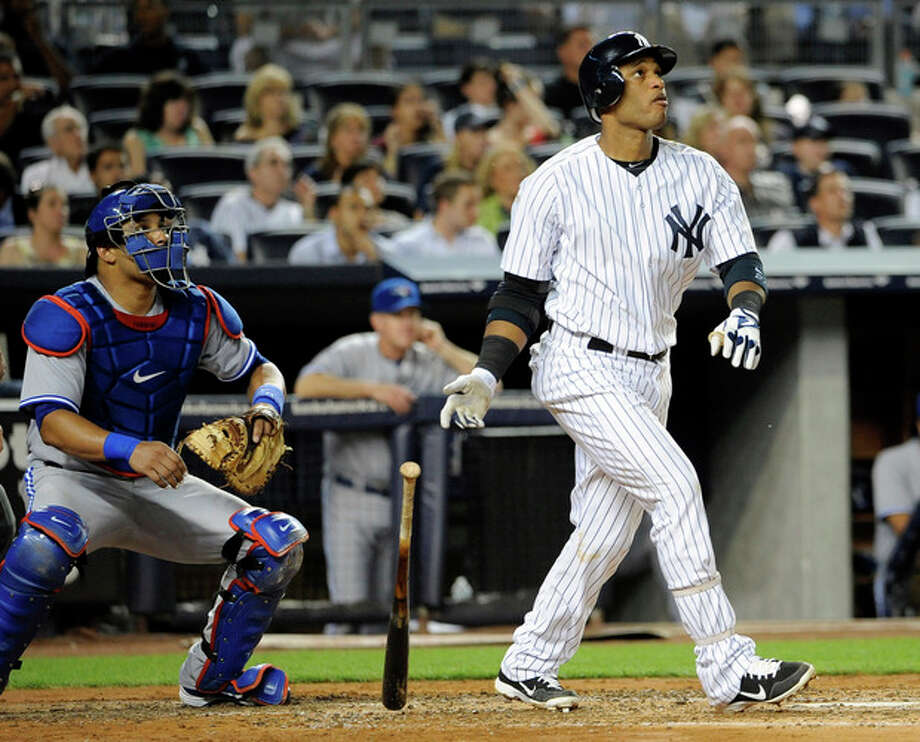 Toronto Blue Jays catcher Yorvit Torrealba watches New York Yankees' Robinson Cano hit his second solo home run in the fourth inning of a baseball game, Monday, Aug. 27, 2012, at Yankee Stadium in New York. (AP Photo/Kathy Kmonicek) / FR170189 AP