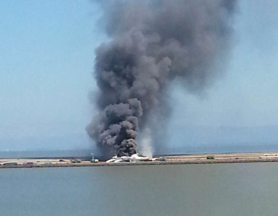 This photo provided by Antonette Edwards shows what a federal aviation official says was an Asiana Airlines flight crashing while landing at San Francisco airport on Saturday, July 6, 2013. It was not immediately known whether there were any injuries. (AP Photo/Antonette Edwards )