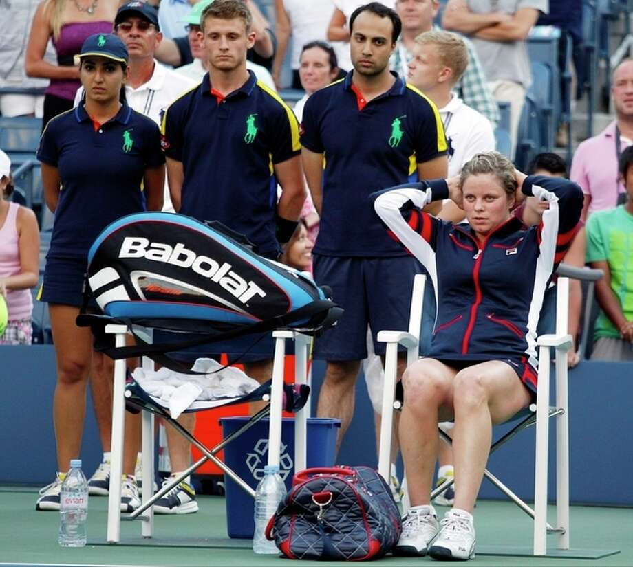 Kim Clijsters of Belgium sits on the side of the court after losing to Laura Robson of Great Britain in the second round of play at the 2012 US Open tennis tournament, Wednesday, Aug. 29, 2012, in New York. (AP Photo/Mel C. Evans) / AP