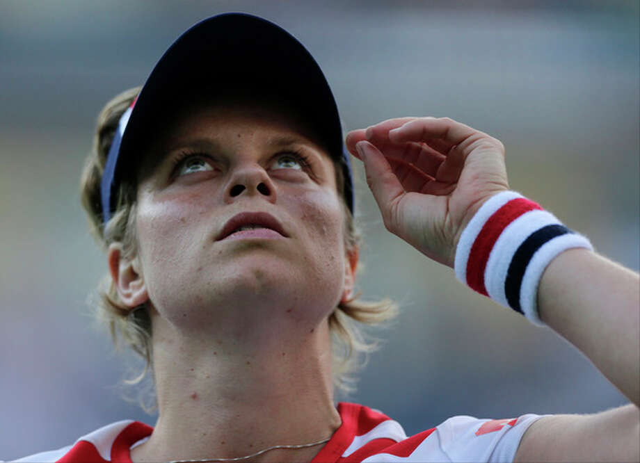 Kim Clijsters of Belgium looks up after losing to Laura Robson of Great Britain in the second round of play at the 2012 US Open tennis tournament, Wednesday, Aug. 29, 2012, in New York. (AP Photo/Charles Krupa) / AP