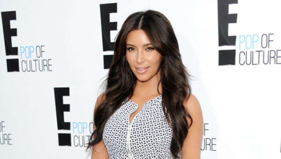 """FILE - In this April 30, 2012 file photo, Kim Kardashian from the show """"Keeping Up With The Kardashians"""" attends an E! Network upfront event at Gotham Hall in New York. Kardashian's lawsuit against Old Navy over an advertisement was dismissed Tuesday Aug. 28, 2012 after the two sides reached a settlement. Kardashian sued the retailer last year, claiming they violated her publicity rights by using a lookalike in an ad. (AP Photo/Evan Agostini, File) / AP"""