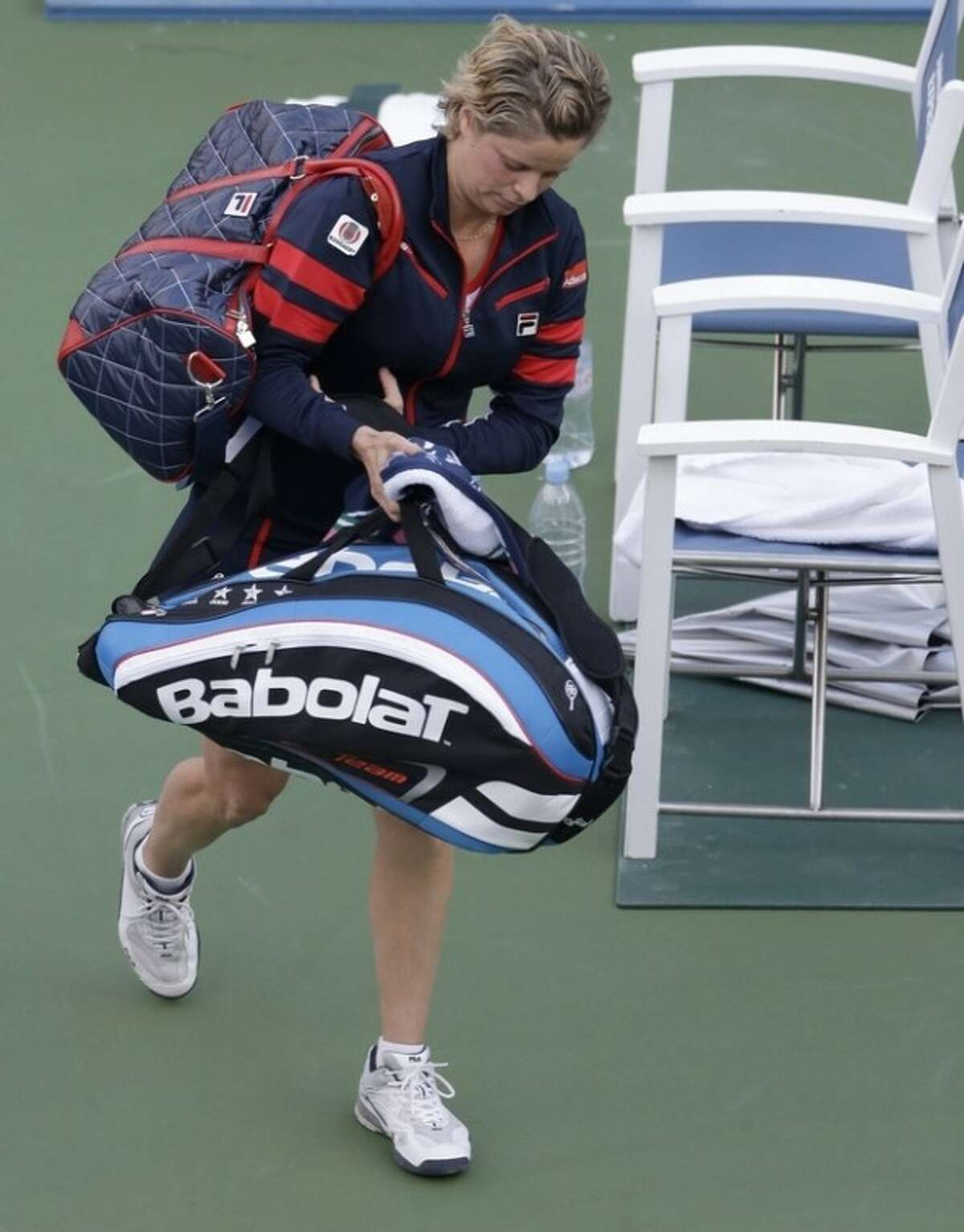 Kim Clijsters of Belgium walks off the court after losing to Laura Robson of Great Britain in the second round of play at the 2012 US Open tennis tournament, Wednesday, Aug. 29, 2012, in New York. (AP Photo/Darron Cummings)