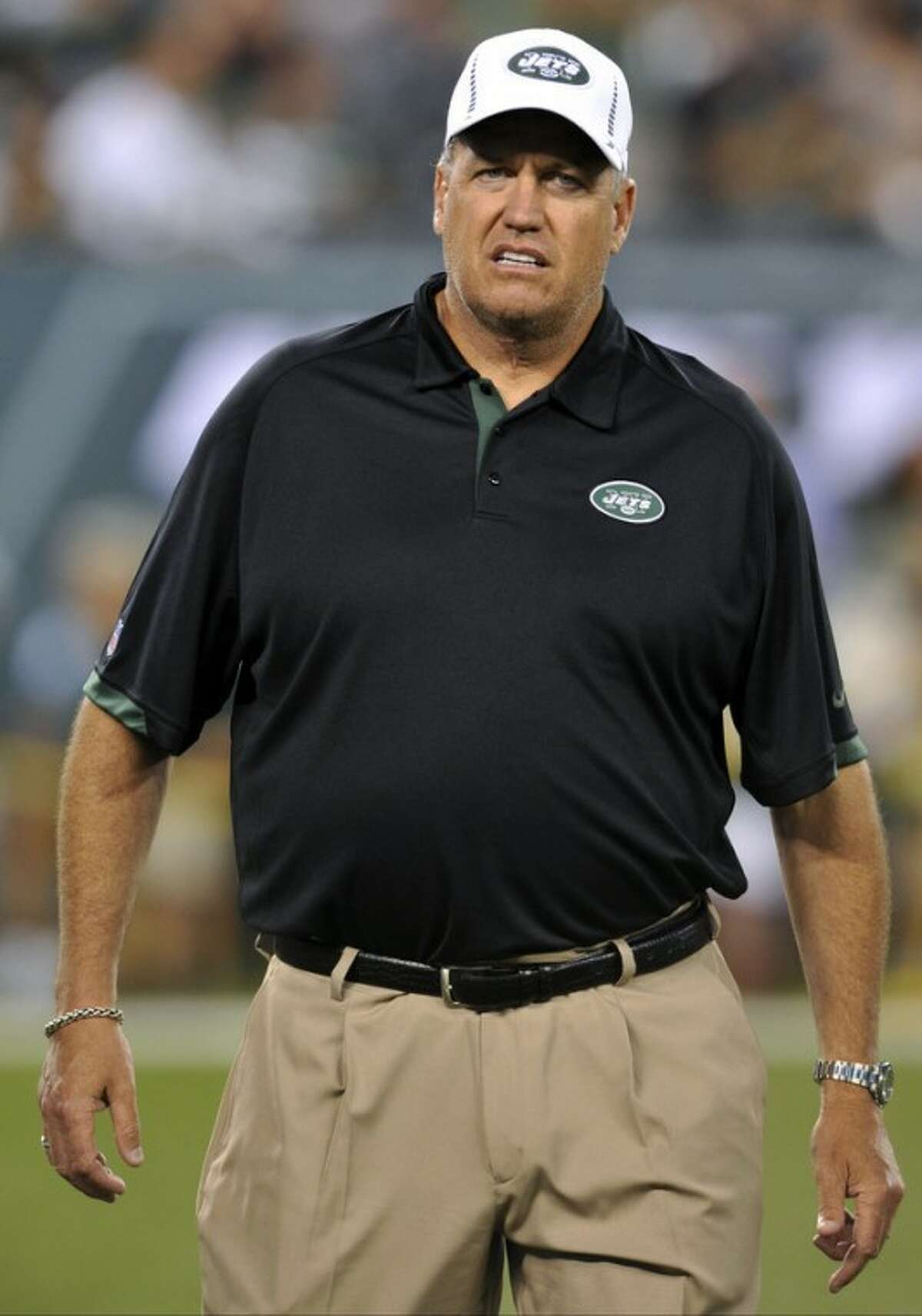 FILE - In this Aug. 26, 2012, file photo, New York Jets head coach Rex Ryan walks on the field before a preseason NFL football game against the Carolina Panthers in East Rutherford, N.J. The Jets' defense, featuring an improved secondary, is shaping up to be one of the toughest in the league but is being overshadowed by a quarterback controversy and the offense's inability to get into the end zone. The Jets are scheduled to begin their regular season on Sept. 9 at home against the Buffalo Bills. (AP Photo/Bill Kostroun, File)