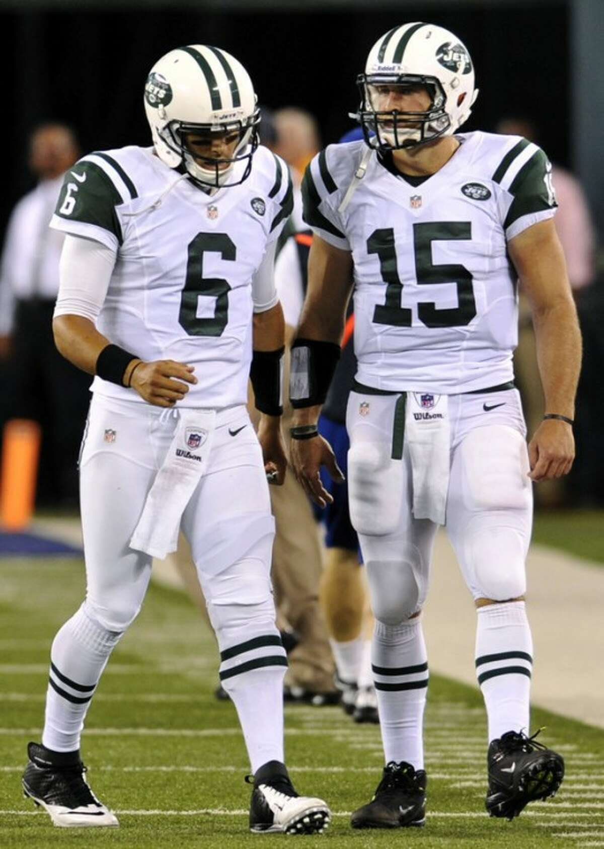 FILE - In this Aug. 18, 2012, file photo, New York Jets quarterback Mark Sanchez (6) meets backup quarterback Tim Tebow after Sanchez threw an interception that was returned for a touchdown during the first half of a preseason NFL football game against the New York Giants in East Rutherford, N.J. The Jets' defense, featuring an improved secondary, is shaping up to be one of the toughest in the league but is being overshadowed by a quarterback controversy and the offense's inability to get into the end zone. The Jets are scheduled to begin their regular season on Sept. 9 at home against the Buffalo Bills. (AP Photo/Bill Kostroun, File)