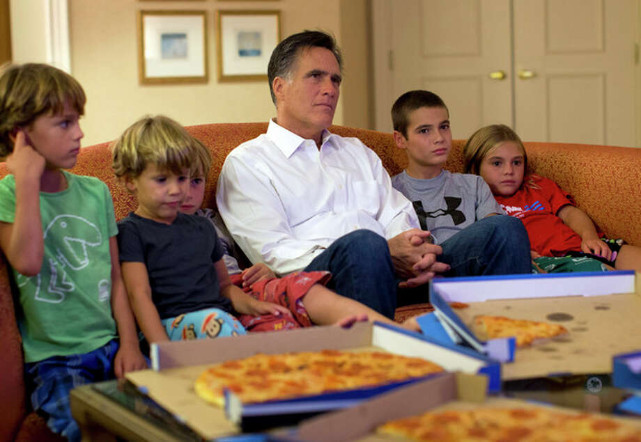 Republican presidential candidate, former Massachusetts Gov. Mitt Romney watches the Republican National Convention with his grandchildren from his hotel room on Wednesday, Aug. 29, 2012 in Tampa, Fla. (AP Photo/Evan Vucci) / AP