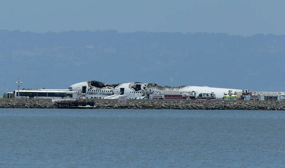 The wreckage of Asiana Flight 214 is seen after it crashed at San Francisco International Airport in San Francisco, Saturday, July 6, 2013. (AP Photo/Jeff Chiu) / AP