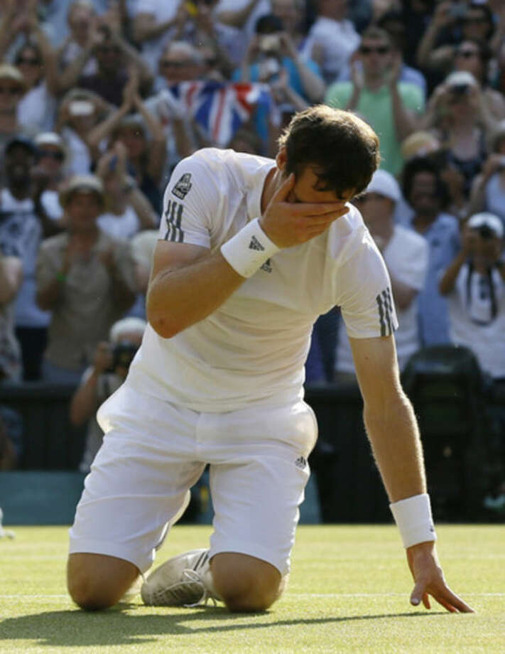 Andy Murray of Britain reacts after winning against Novak Djokovic of Serbia during the Men's singles final match at the All England Lawn Tennis Championships in Wimbledon, London, Sunday, July 7, 2013. (AP Photo/Kirsty Wigglesworth)
