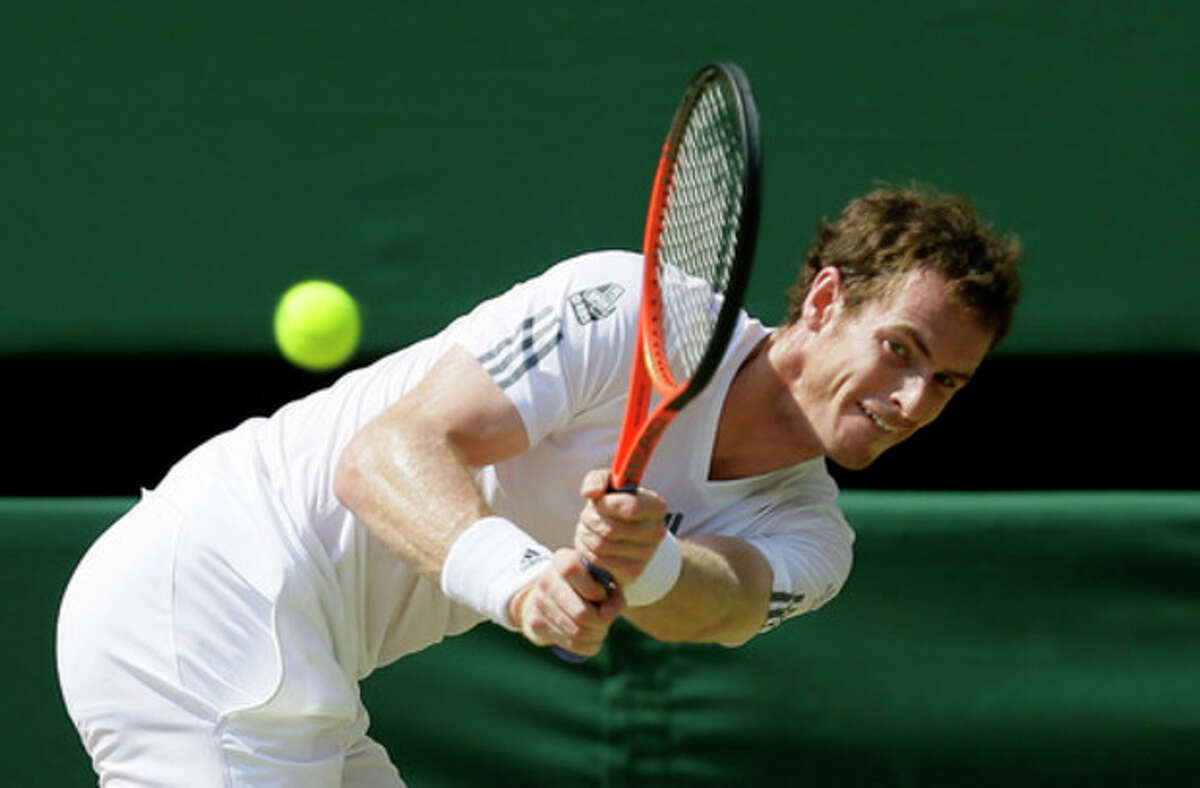 Andy Murray of Britain returns to Novak Djokovic of Serbia during the Men's singles final match at the All England Lawn Tennis Championships in Wimbledon, London, Sunday, July 7, 2013. (AP Photo/Alastair Grant)