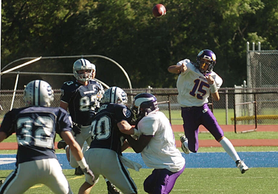 Former Westhiil quarterback Peter Cernansky throws the ball in a game against Staples. Hour file photo / Erik Trautmann / (C)2010 The Hour
