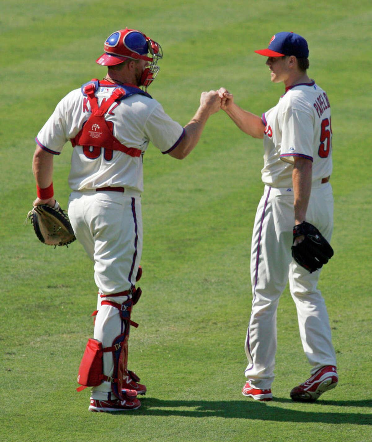 Philadelphia Phillies' Jonathan Papelbon, right celebrates with catcher Erik Kratz after defeating the New York Mets 3-2 in a baseball game Thursday, Aug. 30, 2012, in Philadelphia. (AP Photo/H. Rumph Jr)