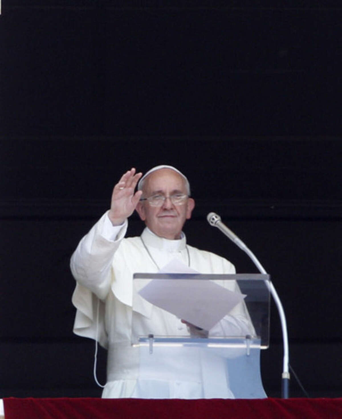 Pope Francis waves to faithful during the Angelus prayer from his studio window overlooking St. Peter's Square at the Vatican, Sunday, July 7, 2013. (AP Photo/Riccardo De Luca)