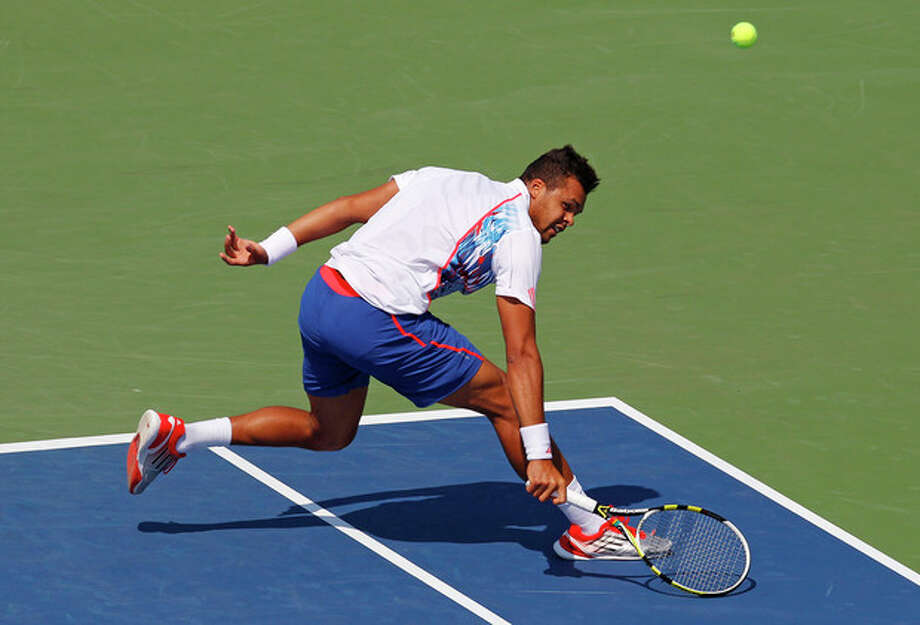 France's Jo-Wilfried Tsonga returns a shot to Slovakia's Martin Klizan in the second round of play at the 2012 US Open tennis tournament, Thursday, Aug. 30, 2012, in New York. Fifth-seeded Tsonga was upset by Klizan in the second round. (AP Photo/Paul Bereswill) / FR168017 AP