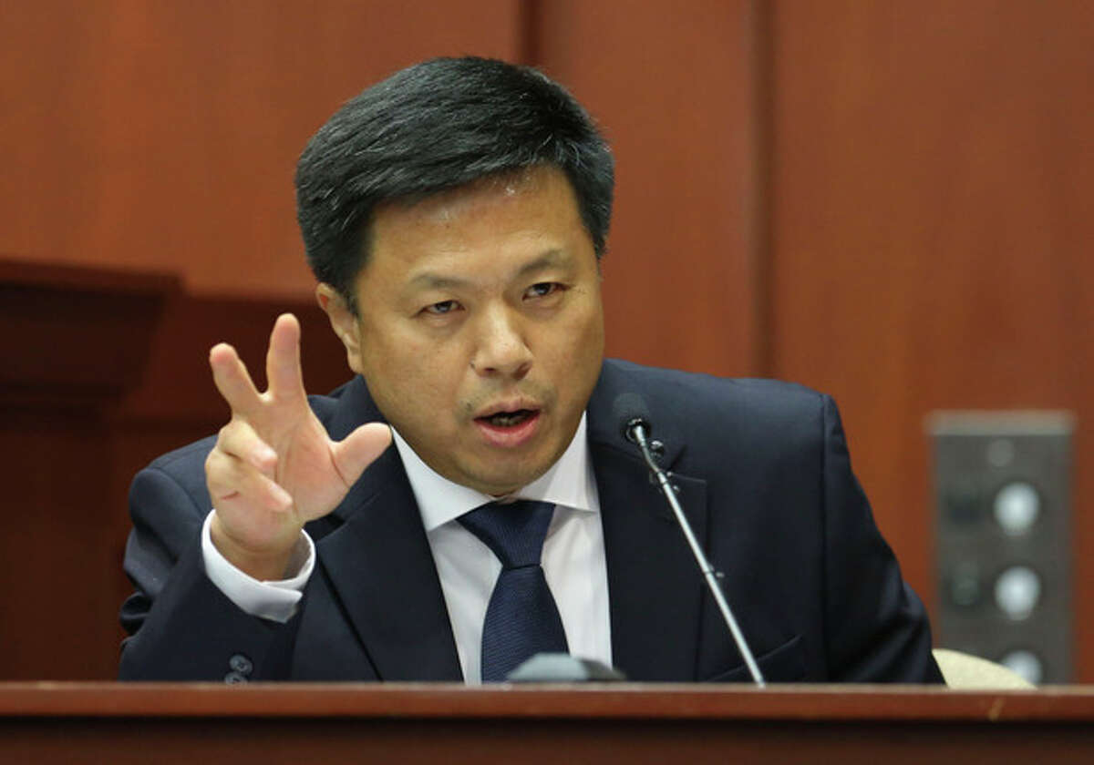 Volusia and Seminole County associate medical examiner Shiping Bao MD testifies during George Zimmerman's trial in Seminole circuit court, Friday, July 5, 2013 in Sanford, Fla. Zimmerman has been charged with second-degree murder for the 2012 shooting death of Trayvon Martin. (AP Photo/Orlando Sentinel, Gary W. Green, Pool)