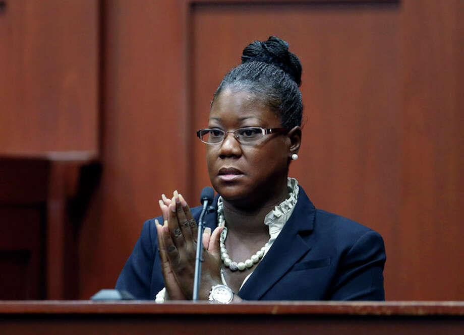 Trayvon Martin's mother, Sybrina Fulton, takes the stand during George Zimmerman's trial in Seminole County circuit court, Friday, July 5, 2013, in Sanford, Fla. Zimmerman has been charged with second-degree murder for the 2012 shooting death of Trayvon Martin. (AP Photo/Orlando Sentinel, Gary W. Green, Pool) / Pool Orlando Sentinel