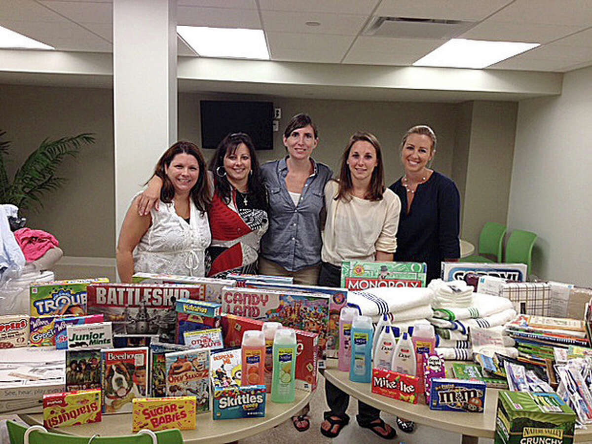 Cellmark employees donate goods to the Open Door Shelter in Norwalk. Contributed photo