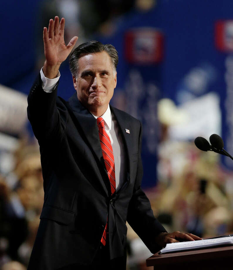 Republican presidential nominee Mitt Romney waves to delegates before speaking at the Republican National Convention in Tampa, Fla., on Thursday, Aug. 30, 2012. (AP Photo/Charlie Neibergall) / AP