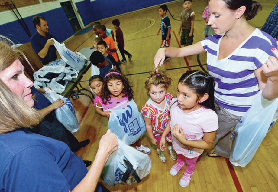 Goodwill donates over 500 backpacks to Kendall Elemenatry School students including members of Cathleen Colpi's 2nd grade class Thursday.Hour photo / Erik Trautmann / (C)2012, The Hour Newspapers, all rights reserved