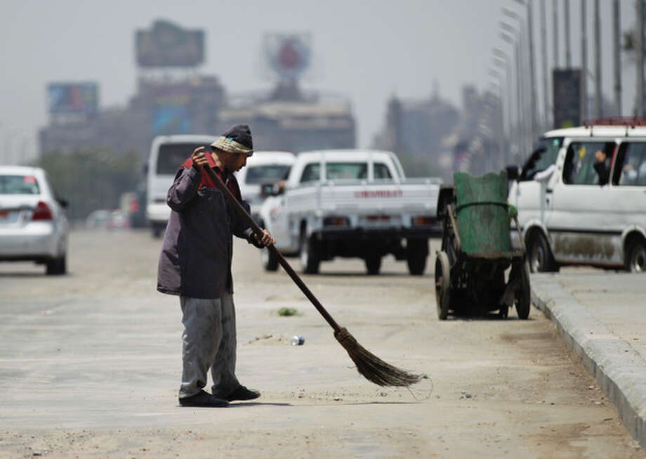 A man sweeps on a bridge leading to Tahrir Square in Cairo Saturday, July 6, 2013. Supporters and opponents of ousted President Mohammed Morsi fought street battles on the bridge Friday night. (AP Photo/Hiro Komae) / AP