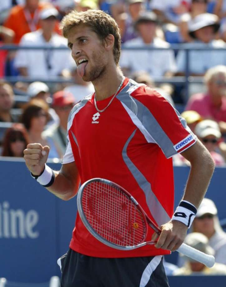 Slovakia's Martin Klizan reacts during his match against France's Jo-Wilfried Tsonga in the second round of play at the 2012 US Open tennis tournament, Thursday, Aug. 30, 2012, in New York. Fifth-seeded Tsonga was upset by Klizan in the second round. (AP Photo/Paul Bereswill)