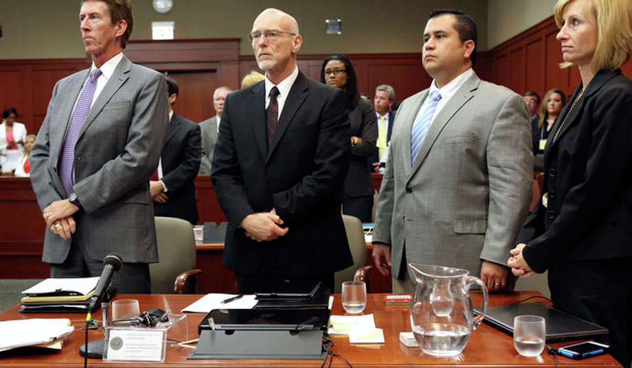 George Zimmerman, second from right, stands with his defense team Mark O'Mara, left, Don West, second from left, and Lorna Truett, right, during his trial in Seminole circuit court in Sanford, Fla. Thursday, July 11, 2013. Zimmerman has been charged with second-degree murder for the 2012 shooting death of Trayvon Martin. (AP Photo/Orlando Sentinel, Gary W. Green, Pool) / Orlando Sentinel
