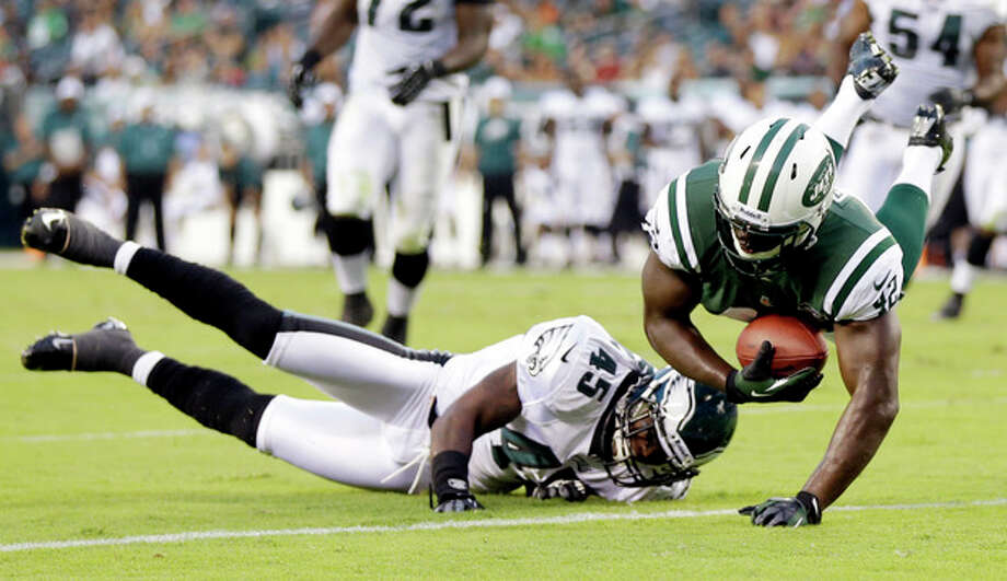 New York Jets running back Terrance Ganaway, right, scores a touchdown over Philadelphia Eagles safety Phillip Thomas in the first half of a preseason NFL football game, Thursday, Aug. 30, 2012, in Philadelphia. (AP Photo/Matt Rourke) / AP