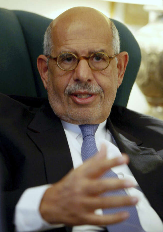 FILE - In this Tuesday, April 30, 2013, file photo, Egypt's leading opposition leader Mohamed ElBaradei speaks to a small group of journalists including The Associated Press at his house on the outskirts of Cairo, Egypt. An opposition spokesman says pro-reform leader Mohamed ElBaradei has been named interim prime minister. Khaled Dawoud of the National Salvation Front, the main opposition grouping, told The Associated Press that interim President Adly Mansour will swear in ElBaradei on Saturday evening.(AP Photo/Khalil Hamra, File)