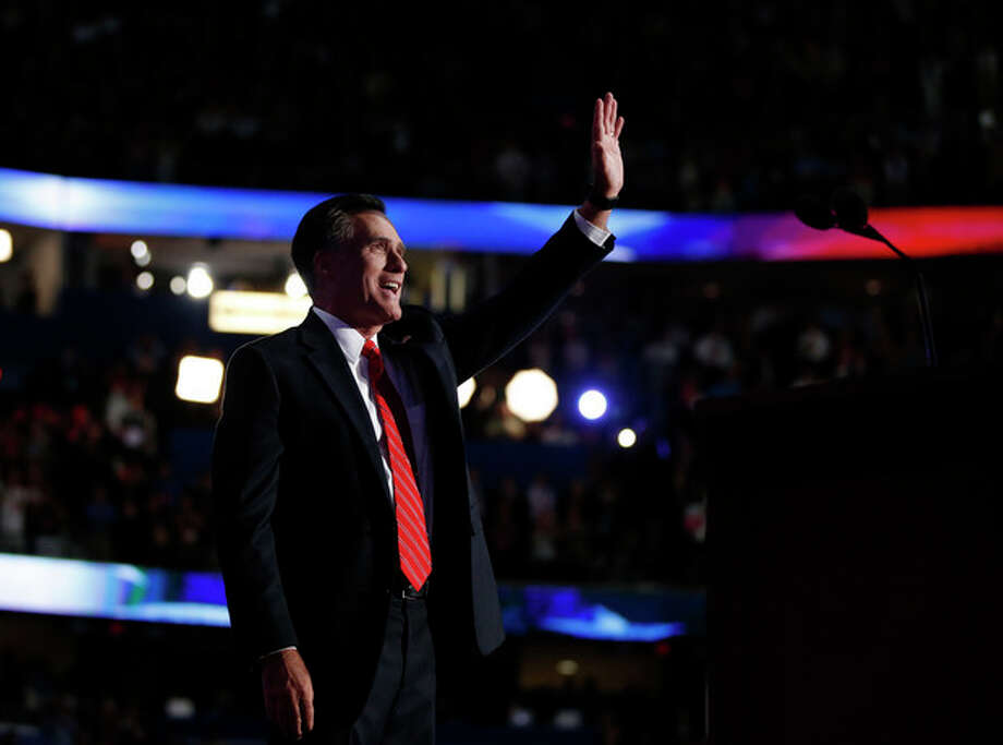 Republican presidential nominee Mitt Romney acknowledges delegates before speaking at the Republican National Convention in Tampa, Fla., on Thursday, Aug. 30, 2012. (AP Photo/Jae C. Hong) / AP