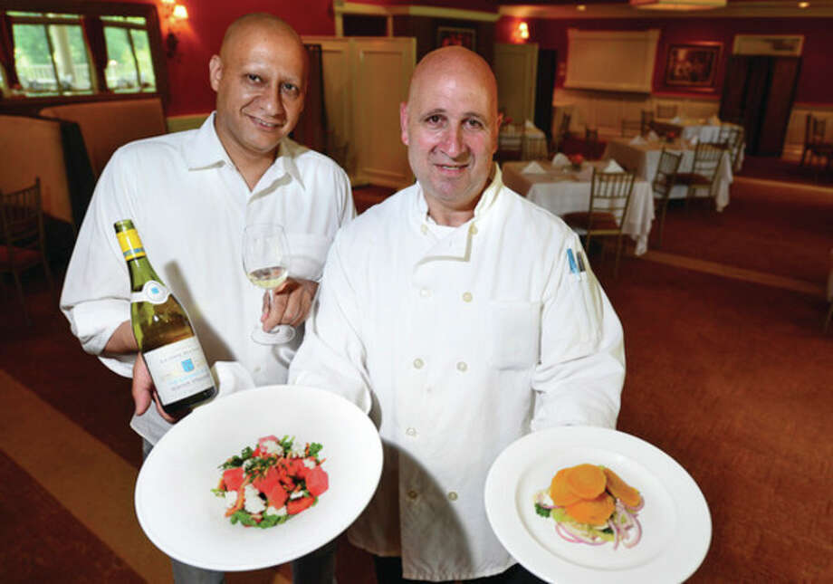 Hour photo / Erik TrautmannOwner Amar Haouri and Chef Vincent La Forte hope the restaurant at Oak Hills Park is more successful than prior ones in giving the golfers and public what they've been looking for. / (C)2013, The Hour Newspapers, all rights reserved