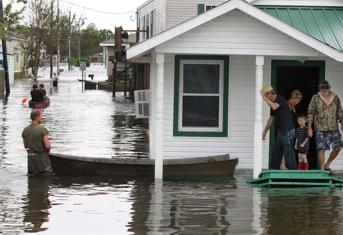 Flooding in Lafitte, La., causes residents to travel by boat on Thursday, Aug. 30, 2012, a day after Hurricane Isaac hit the area near New Orleans. (AP Photo/Erik Schelzig)