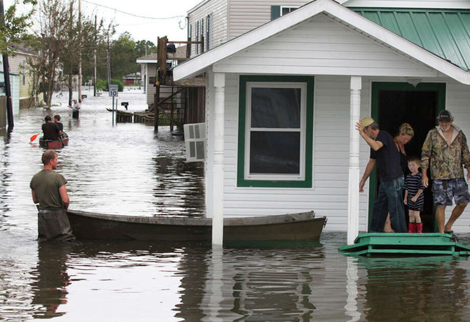 Flooding in Lafitte, La., causes residents to travel by boat on Thursday, Aug. 30, 2012, a day after Hurricane Isaac hit the area near New Orleans. (AP Photo/Erik Schelzig) / AP