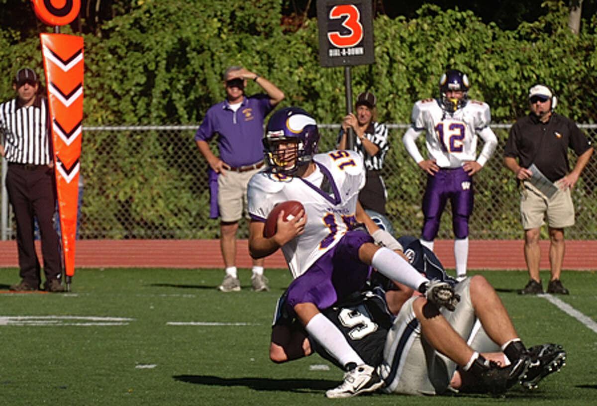 Westhiil quarterback Peter Cernansky gets taken down in a game against Staples. Hour file photo / Erik Trautmann