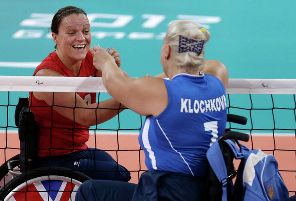 Martine Wright, left, of Britain shakes hands with Larysa Klochkova left, of Ukraine, prior to their women' sitting volleyball match at the 2012 Paralympics games, Friday, Aug. 31, 2012, in London. On July 7, 2005, four suicide bombers detonated explosives on London?'s transit system, killing 52 commuters and the four attackers. Wright was among the injured on 7/7, losing both her legs. Seven years later, she?'s been transformed into an athlete, a Paralympian.(AP Photo/Alastair Grant)