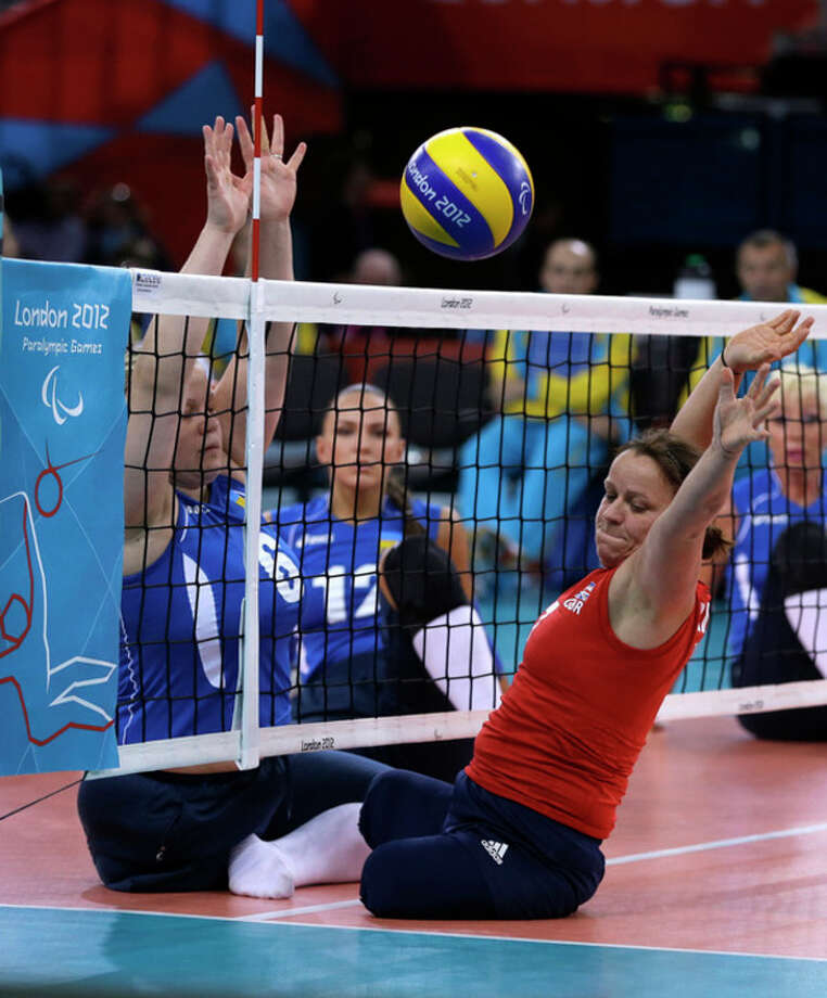 Martine Wright, right, of Britain fails to return the ball from Ilona Yudina, left, of Ukraine, during their women' sitting volleyball match at the 2012 Paralympics games, Friday, Aug. 31, 2012, in London. On July 7, 2005, four suicide bombers detonated explosives on London's transit system, killing 52 commuters and the four attackers. Wright was among the injured on 7/7, losing both her legs. Seven years later, she's been transformed into an athlete, a Paralympian.(AP Photo/Alastair Grant) / AP