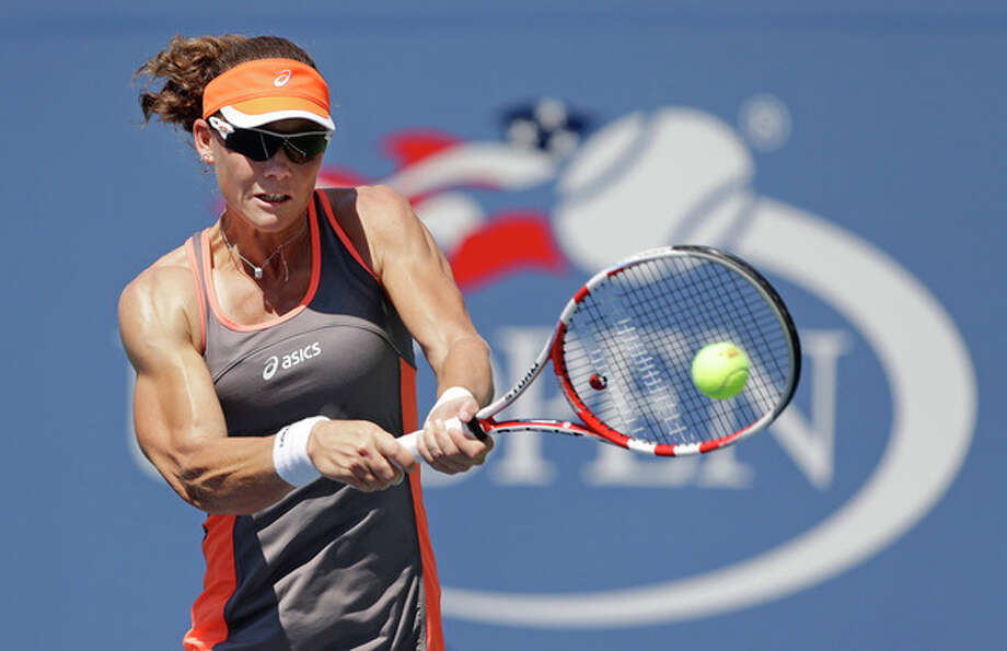 Samantha Stosur, of Australia, returns a shot to Varvara Lepchenko in the third round of play at the 2012 US Open tennis tournament, Friday, Aug. 31, 2012, in New York. Stosur won the match. (AP Photo/Mike Groll) / AP