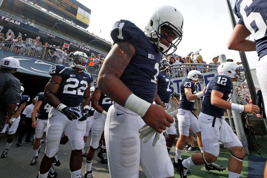 Penn State's Bill Belton (1) runs onto the field for warm ups before an NCAA college football game against Ohio at Beaver Stadium in State College, Pa., Saturday, Sept. 1, 2012. (AP Photo/Gene J. Puskar) / AP